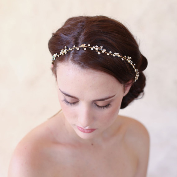 For the brides who want to keep her bridal hair accessories to a minimal, this simple wedding hair accessory is a sublime choice for a cheap wedding tiara. The minimalist rhinestones that line the sides give your hairstyle a bit of a sparkle without overpowering your overall look.