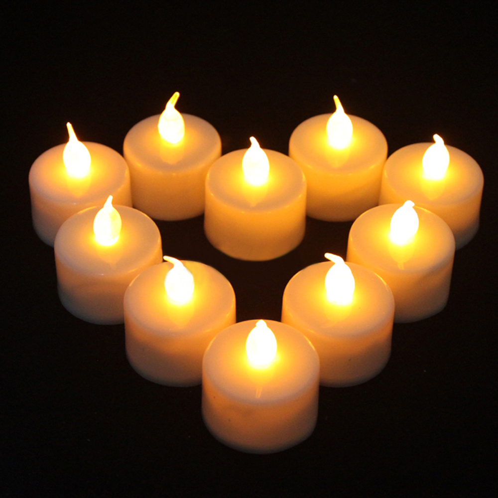 12pcs LED Tealight Battery Operated Flickering Flicker Flameless Tea Candles Light for Wedding Birthday Party Christmas Home(China (Mainland))