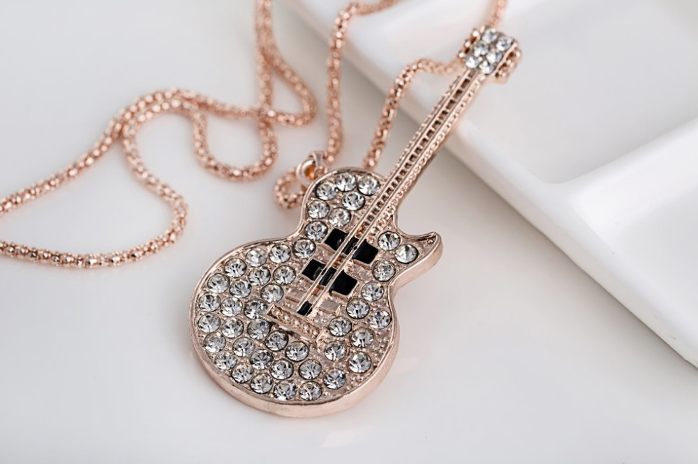 2015 new Korean fashion necklace guitar notes long sweater chain(China (Mainland))