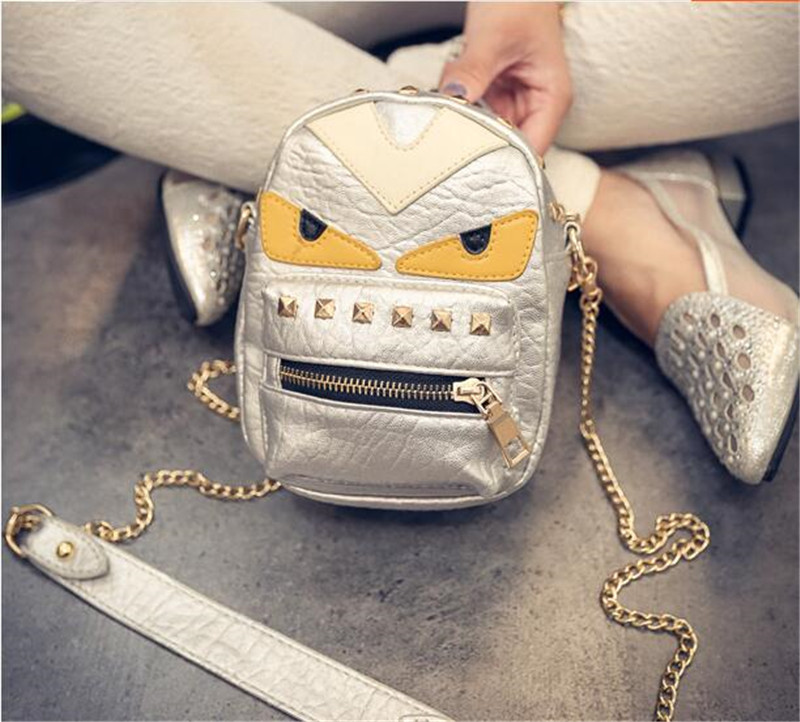 New handbag little devil little monster hit color eye bag mini shoulder bag rivets Messenger(China (Mainland))