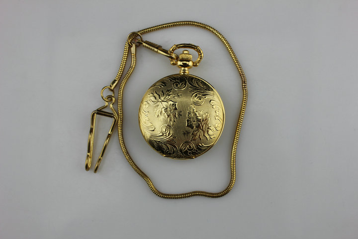 Quartz pocket watch gold pocket watch antique table