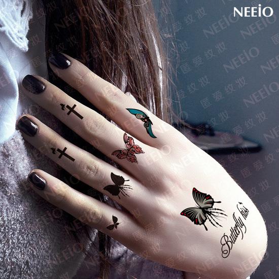 Acheter tatouage temporaire papillon doigt croix main oreille autocollants de - Tatouage croix main ...
