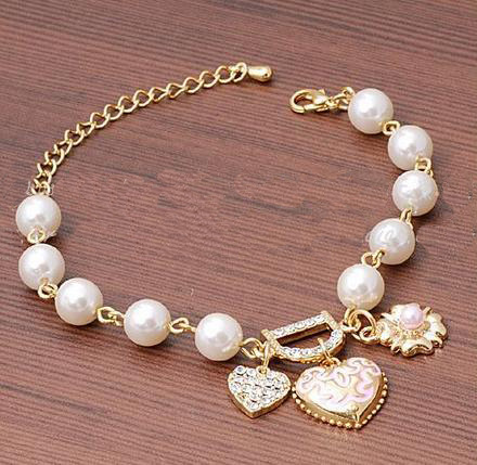 New delicate hand act the role of sell like hot cakes Peach flower heart crystal pendant ms pearl bracelet(China (Mainland))