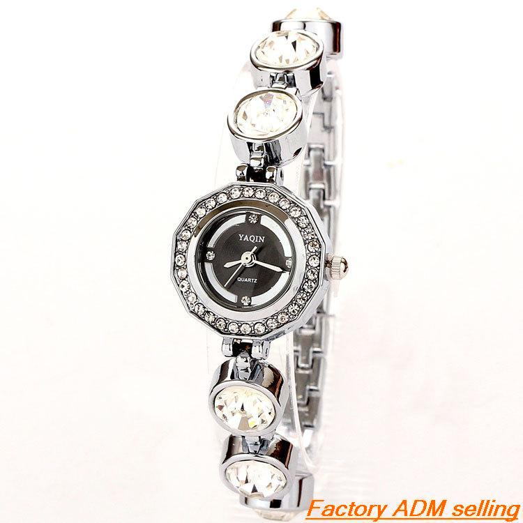 Wholesale Personalized Luxury Quartz Watch Women Fashion Sliver promotional watches Big Diamond Rhinestone Bracelet Watch Women(China (Mainland))