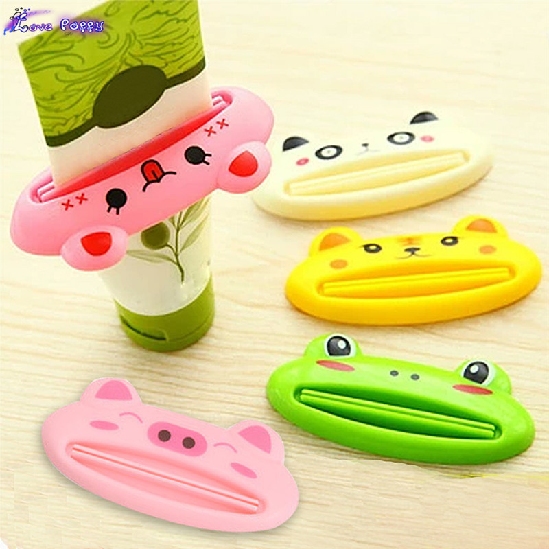 ABS Bathroom Home Tube Squeezer Easy Cartoon Toothpaste Dispenser Rolling Holder 1062(China (Mainland))