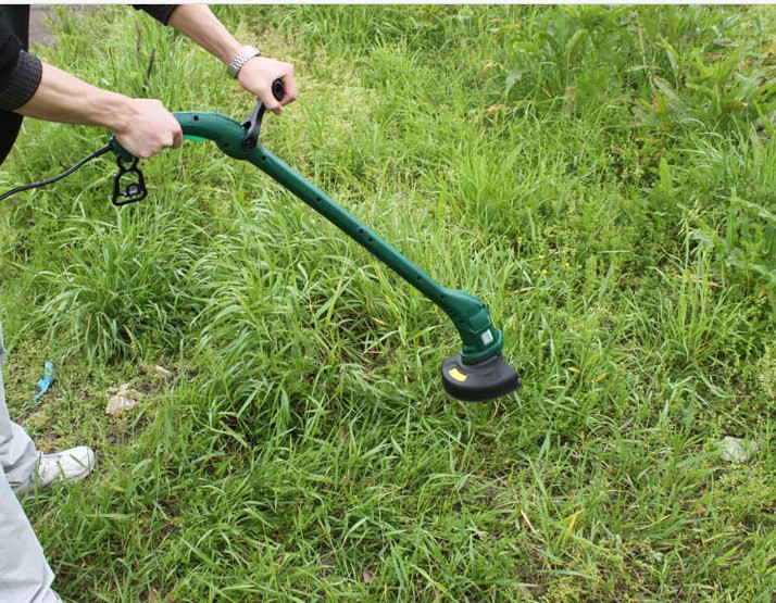 Portable grass trimmer multifunction small household electric lawn mower machine(China (Mainland))