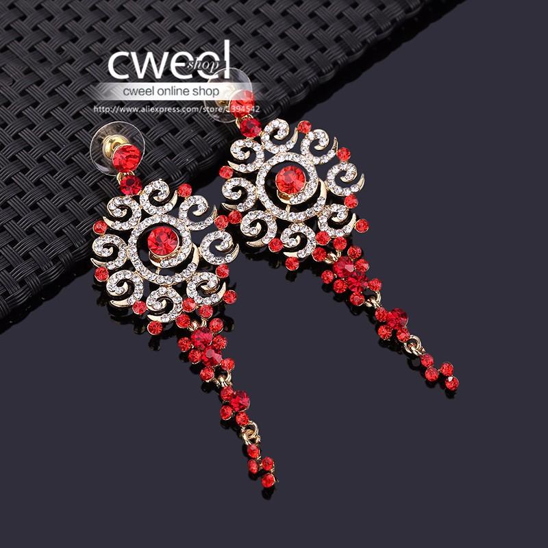 Длинные серьги позолоченные с красными кристаллами. фото