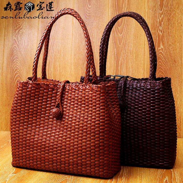 The new summer Italy import head layer cowhide leather handbag anti handmade rattan weaving basket bag(China (Mainland))