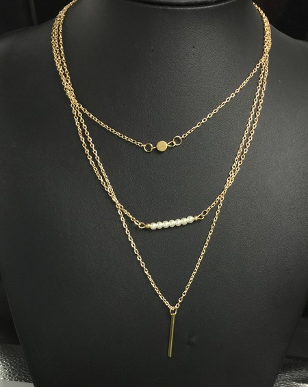 Многослойное ожерелье под золото с подвесками. фото