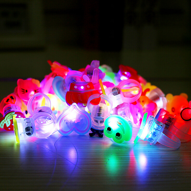 Hot 10pcs Kids Cartoon LED Flashing Light Up Glowing Finger Rings Electronic Christmas Halloween Toys Gifts for Children 2016(China (Mainland))