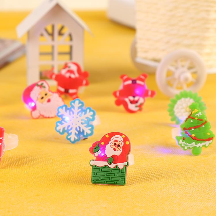 Hot Selling Christmas toys Plastic Luminous toy gifts children Cartoon carnival finger flash light up creative fun Flashing Ring(China (Mainland))
