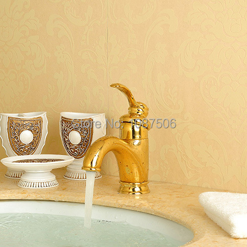 Free shipping luxury basin faucet polished golden under counter bathroom mixer water tap single handle hole hot and cold water(China (Mainland))