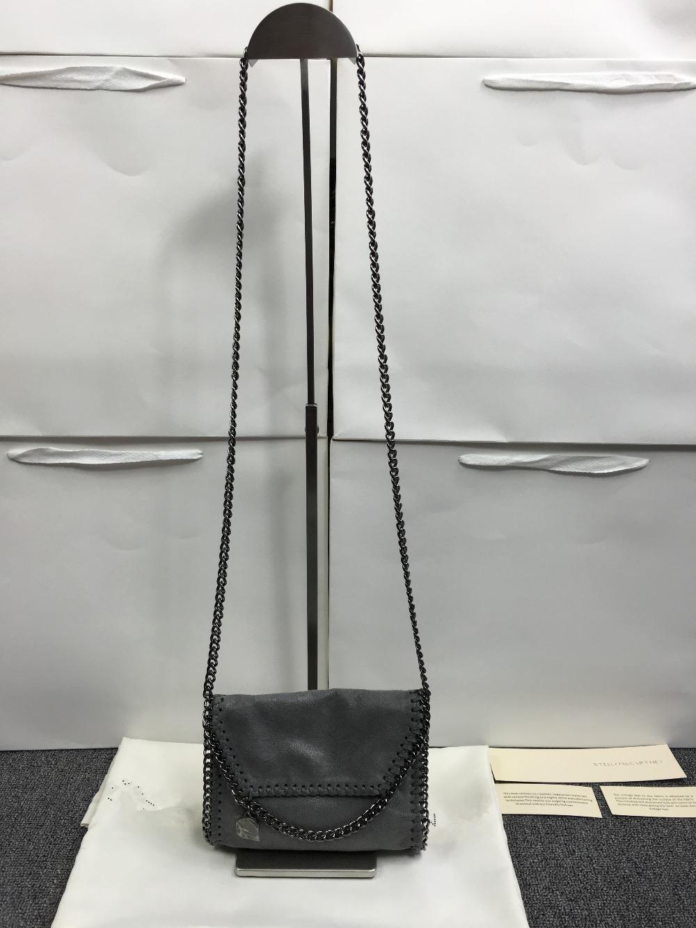 Фотография mini lady bag 2016 NEW  list    CHAIN handbag original material PVC S*T package with logo Shoulder women silver chain  bag