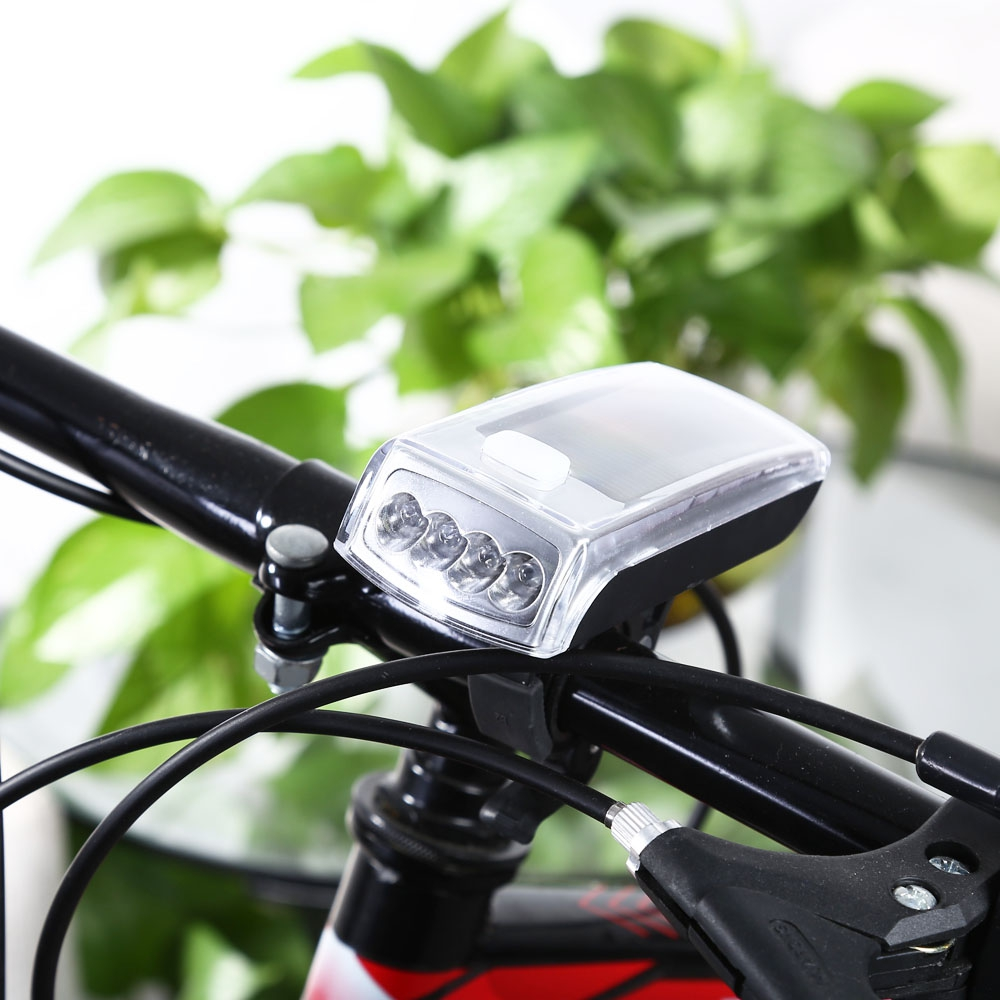 4-LED Solar Bike Head Light Shockproof Front Torch Lamp Cycling Bike Light Water Resistant Outdoor Equipment(China (Mainland))