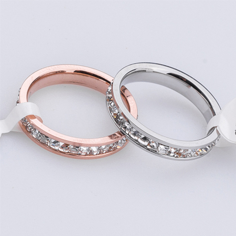 Hot sell Super flash single small CZ diamond ring for women rose gold 316 titanium steel crystal finger rings(China (Mainland))