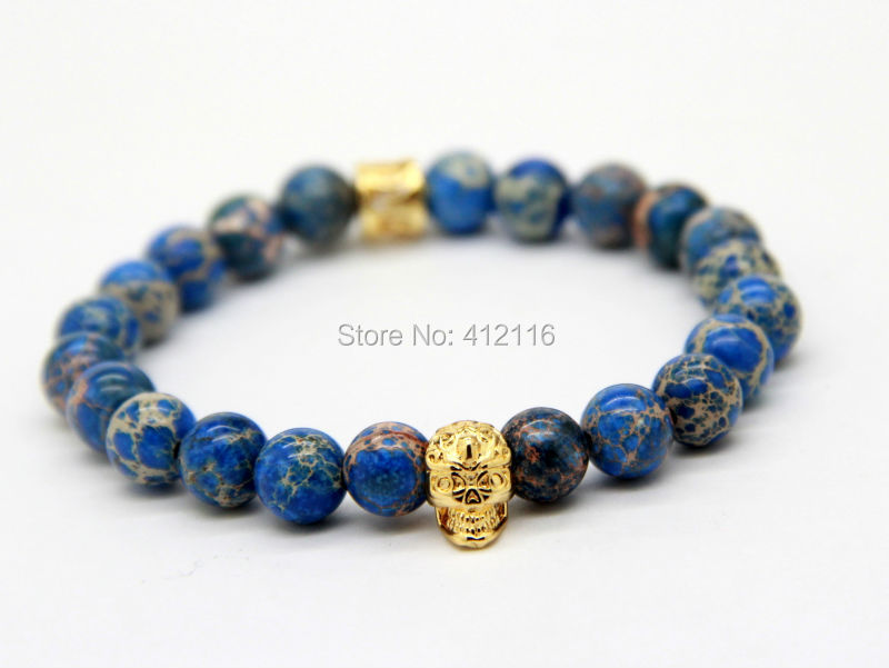 2015 New Design High Grade Jewelry Wholesale 8mm Blue Sea Sediment Stone Bead with Bronze Gold and Silver Skull Bracelet(China (Mainland))