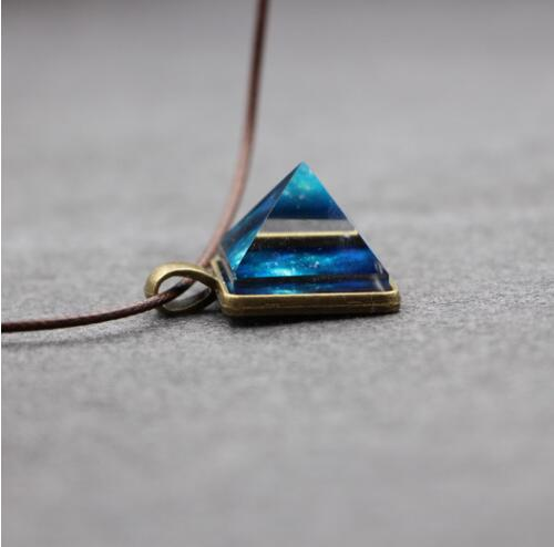 2016 Hot 2017 Glowing Crystal Glow in the Dark Pyramid Pendant Outer Space Star Dust Necklace Triangle Geometric Magic Necklace(China (Mainland))