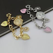 Caliente venta Fashionab corazón pulsera elegante análogo de cuarzo señora de WristWatch mujeres rosa relojes de oro mujeres reloj pulsera