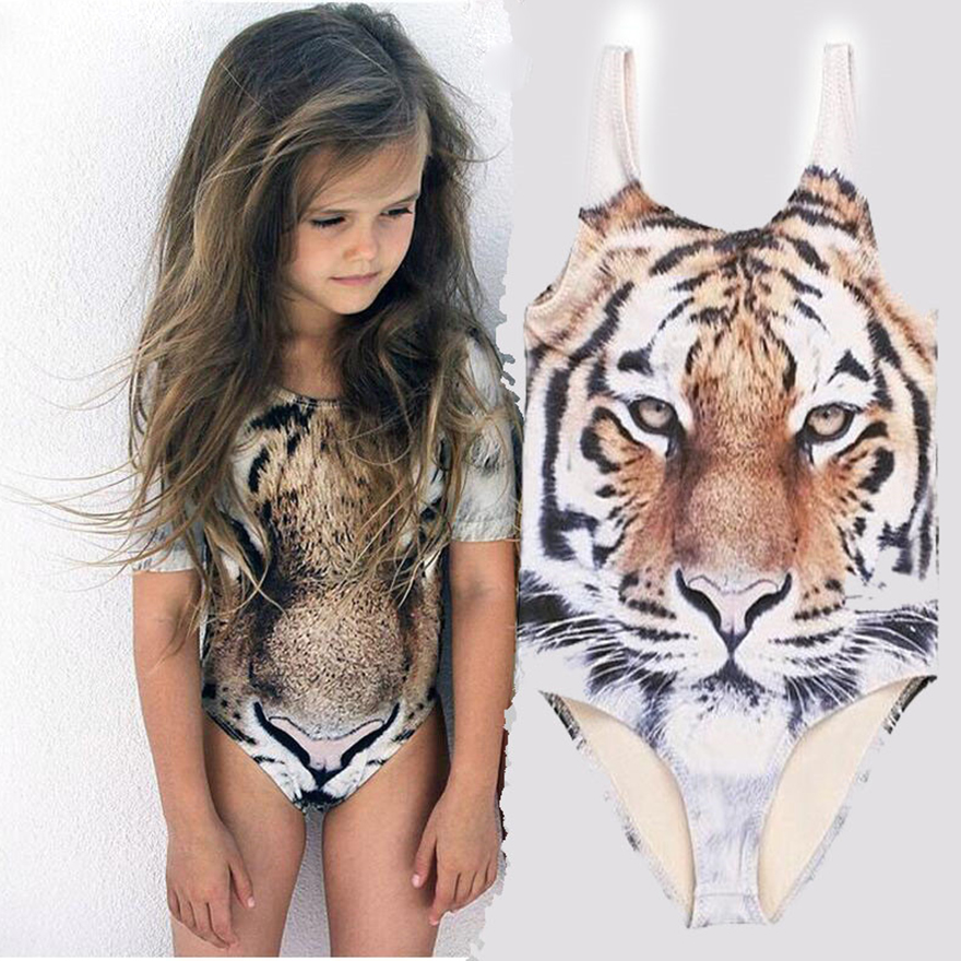 A Tiger face in scanned British stamps Hit the pool and beach in your own personally designed one-piece swimsuit! Our one piece swimsuits are fully customizable from the front to the back and the straps as well so you let your inner designer run free and create a piece that will be sure to wow everyone this summer!