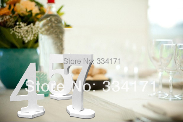 9pcs/lot white color elegant cut out table number with holders for wedding party(China (Mainland))