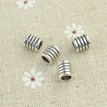50pcs/lot metal vintage tibetan silver spiral charms diy beads for European bracelets