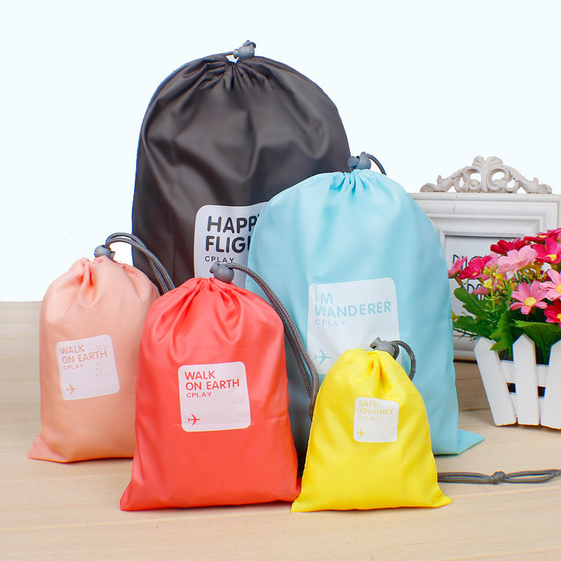 4PCS/LOT Simple And Lovely Polyester Travel Storage Bags Used To Storage Clothes Portable Bag Free Shipping(China (Mainland))