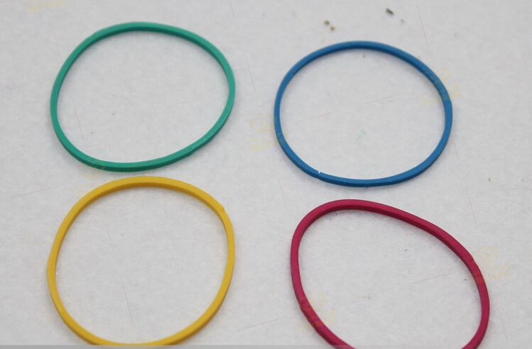 Magician dedicated, high elasticity colored rubber band, rubber band through the four-color, close-up magic props necessary(China (Mainland))