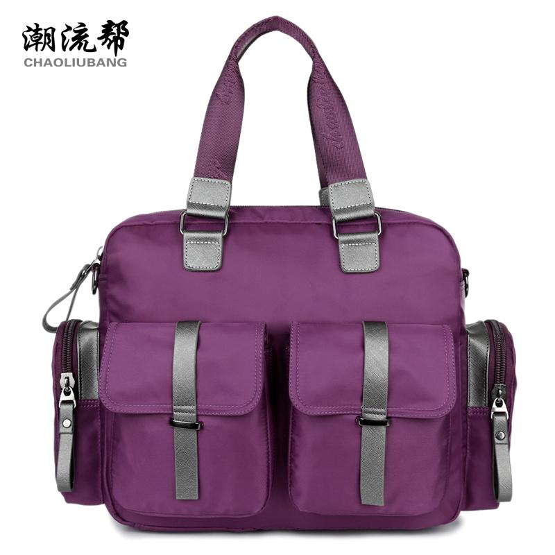 Brand high quality men and women's handbag The large capacity waterproof nylon leisure and travel bag England style black bag(China (Mainland))