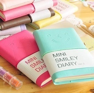 2015 new school supplies stationery lovely smile expression diary book cute notepad hotsell 8 colors notebook caderno(China (Mainland))
