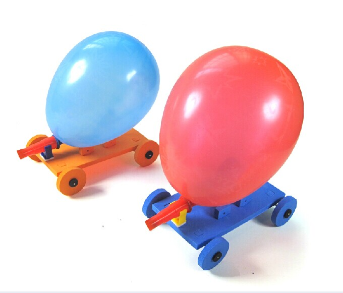 balloon powered car Put the long end of a flexible straw into a balloon poke two holes in the bottle's sides, on the part of the bottle that will be the bottom of the car make the holes directly across from each other so the axle goes straight across slide a straw through the two holes adjust so the axle goes.