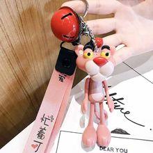 Aleatoriamente sentcartoon bonito boneca animal rosa pantera chaveiro anéis de couro corda sinos chaveiros feminino saco do carro encantos pingente(China)