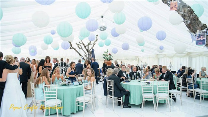 Pastel-paper-lanterns-in-wedding-marquee
