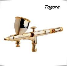 Marca » Tagore » TG180G Hot New 24 quilates chapado en oro 0.2 MM 9CC alimentación por gravedad Mini arma de aerosol del aerógrafo pluma porque Tattoo maquillaje pastel