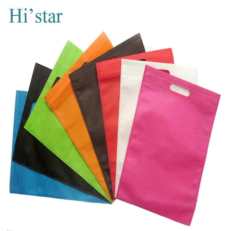 25*30cm 20 pieces/lot Free shipping 50pcs non woven bags with handle Beige color bags with Black dot printing(China (Mainland))