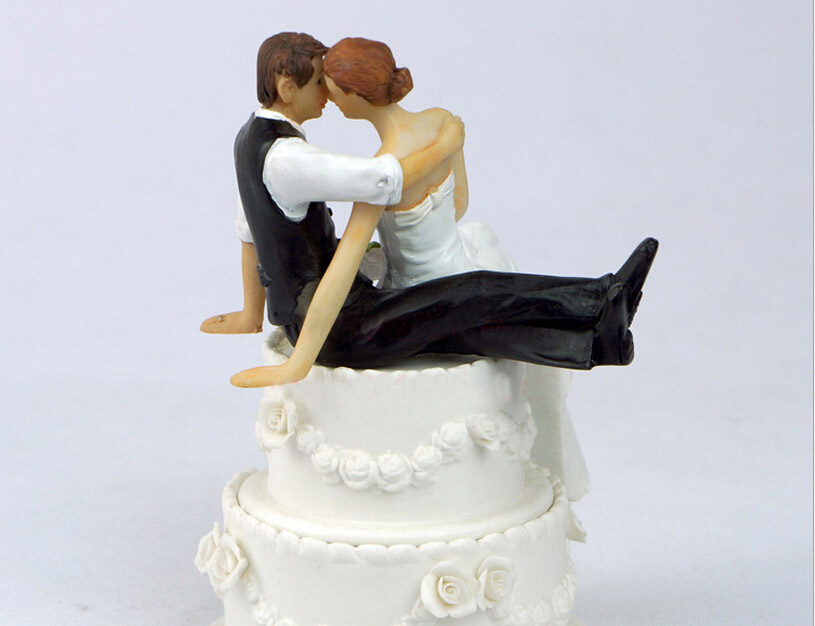 Bride And Groom Sitting Wedding Cake Topper