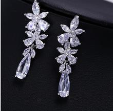 2014 New hot sale Fashion petal flower earrings long section of a grain of rice and fresh delicate woman free shipping(China (Mainland))
