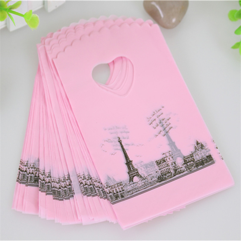 2016 Hot Sale Wholesale 50pcs/lot Pink Eiffel Tower Packaging Bags Plastic Shopping Bags With Handle Small Gift Bags(China (Mainland))